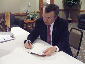 RCC President signs his Rachel Carson book