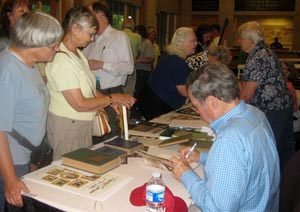 RCC's President Bob Musil signs books at the NCTS