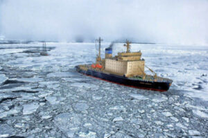 image of ice cutter moving through sea ice shows the effects of climate change