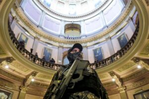 image of armed insurrectionist in the capitol