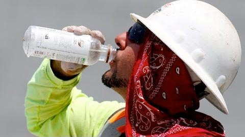 image of worker drinking water in the summer
